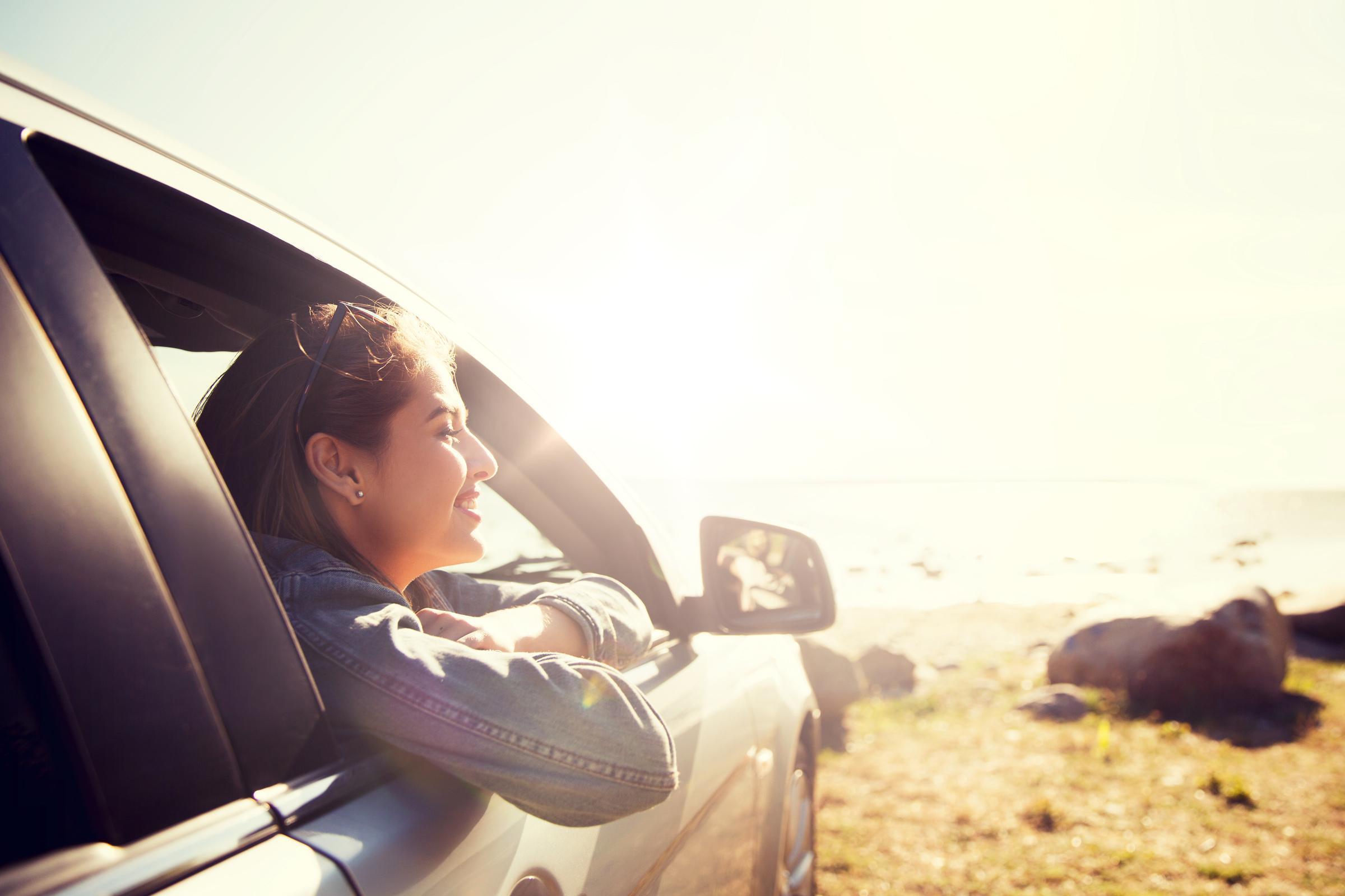 Happy woman inside a car