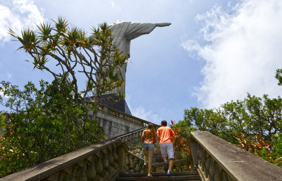 couple walking up the stairs at christ the redeemer in rio de janeiro