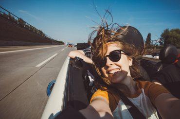 woman taking a selfie in a car