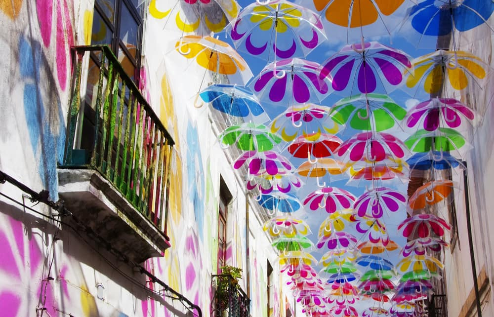 colorful umbrellas in the sky of beja in portugal