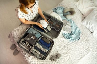 woman packing a bag for travel