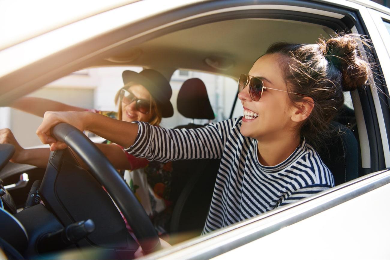 friends driving a car