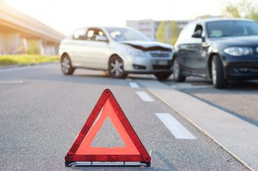 red triangle indicating car crash on the background