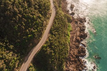aerial view of road and sea